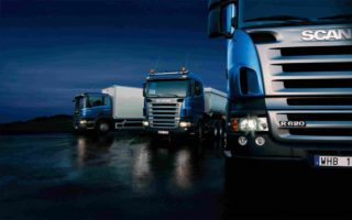 http://www.omicmyanmar.com/wp-content/uploads/2015/09/Three-trucks-on-blue-background-320x200.jpg